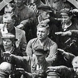 A German worker refuses to raise his arm to give the nazi salute at Hitler's arrival to his factory, Hamburg, 1936.